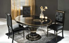 dining room Dark Dining Rooms: The Right Choice black oval table and black chairs on the fur rug 240x150
