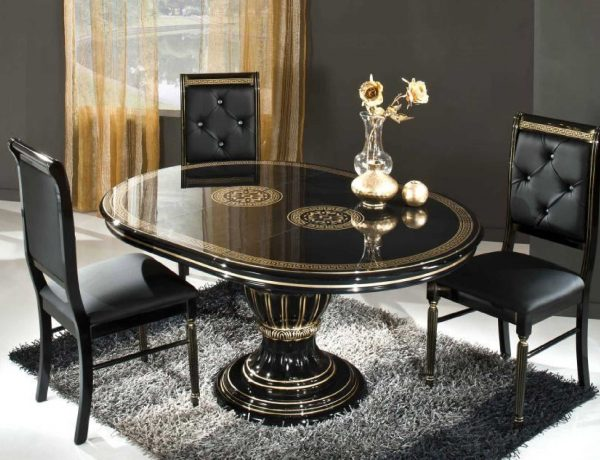 dining room Dark Dining Rooms: The Right Choice black oval table and black chairs on the fur rug 600x460